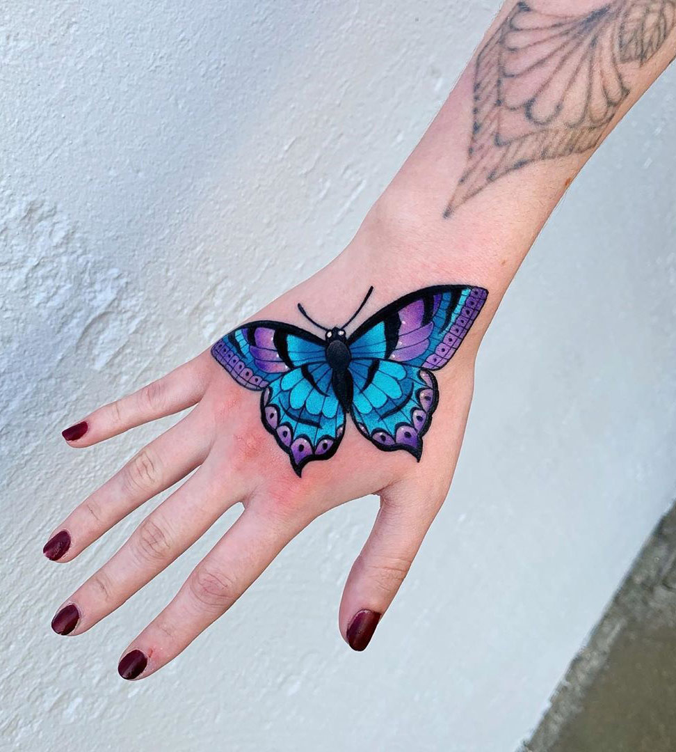 Butterfly on Girl's Hand
