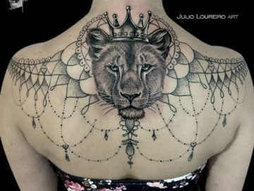 Lioness girl's back tattoo