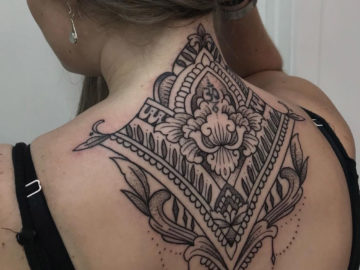 Pretty mandala neck tattoo