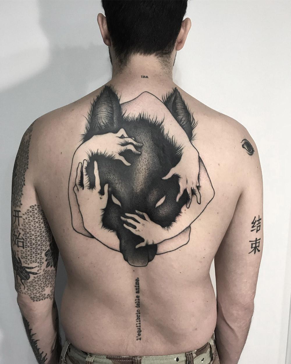 Black Wolf back tattoo