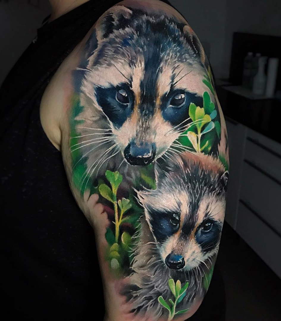 Raccoons arm tattoo