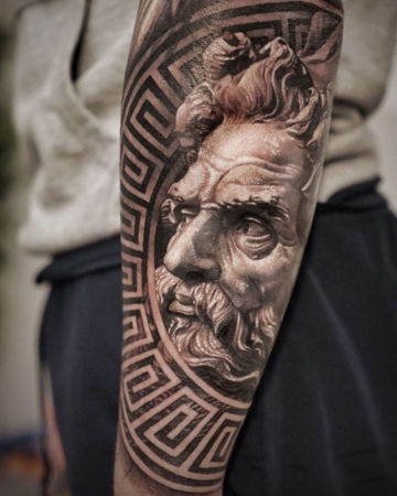 Poseidon men's forearm tattoo idea