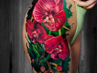 Red Orchids hip tattoo