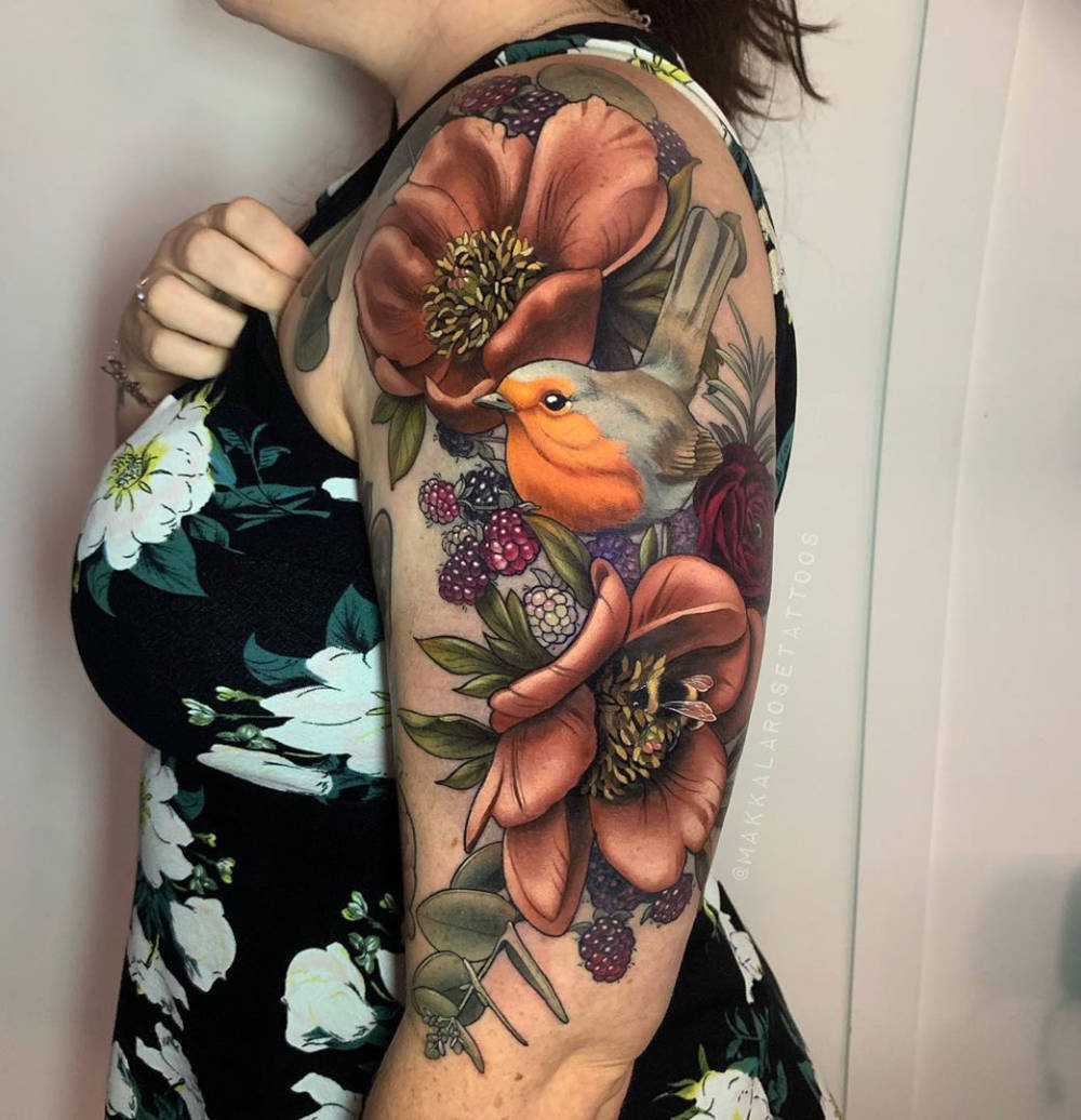 Pretty bird arm tattoo