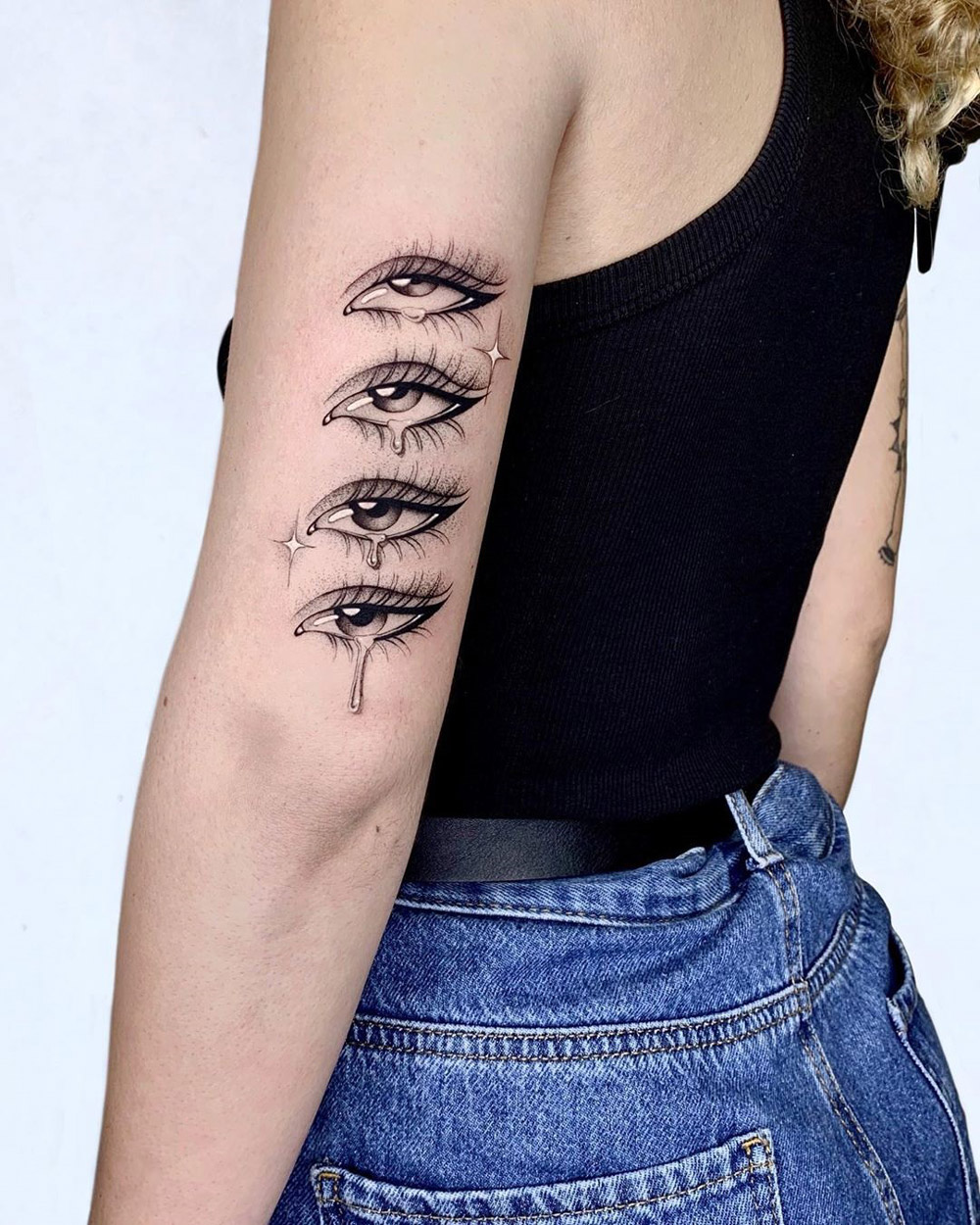 Crying Eyes, girl's arm tattoo