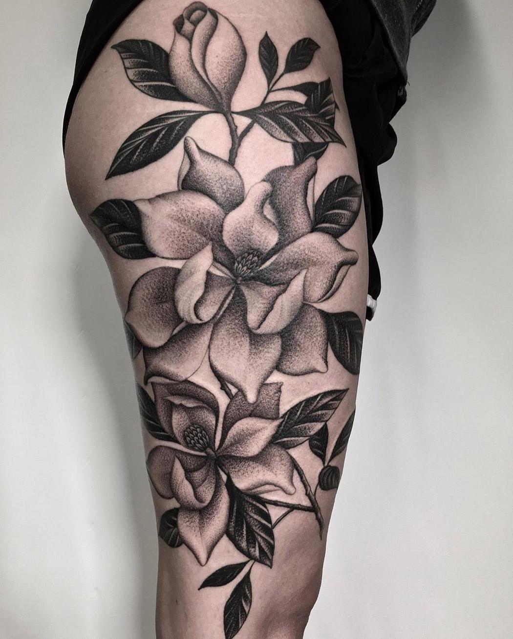 Magnolias b&g thigh tattoo