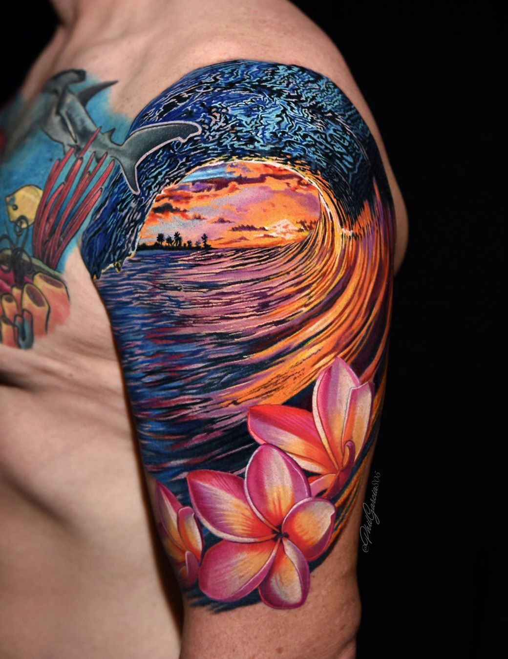 Wave and flowers arm tattoo