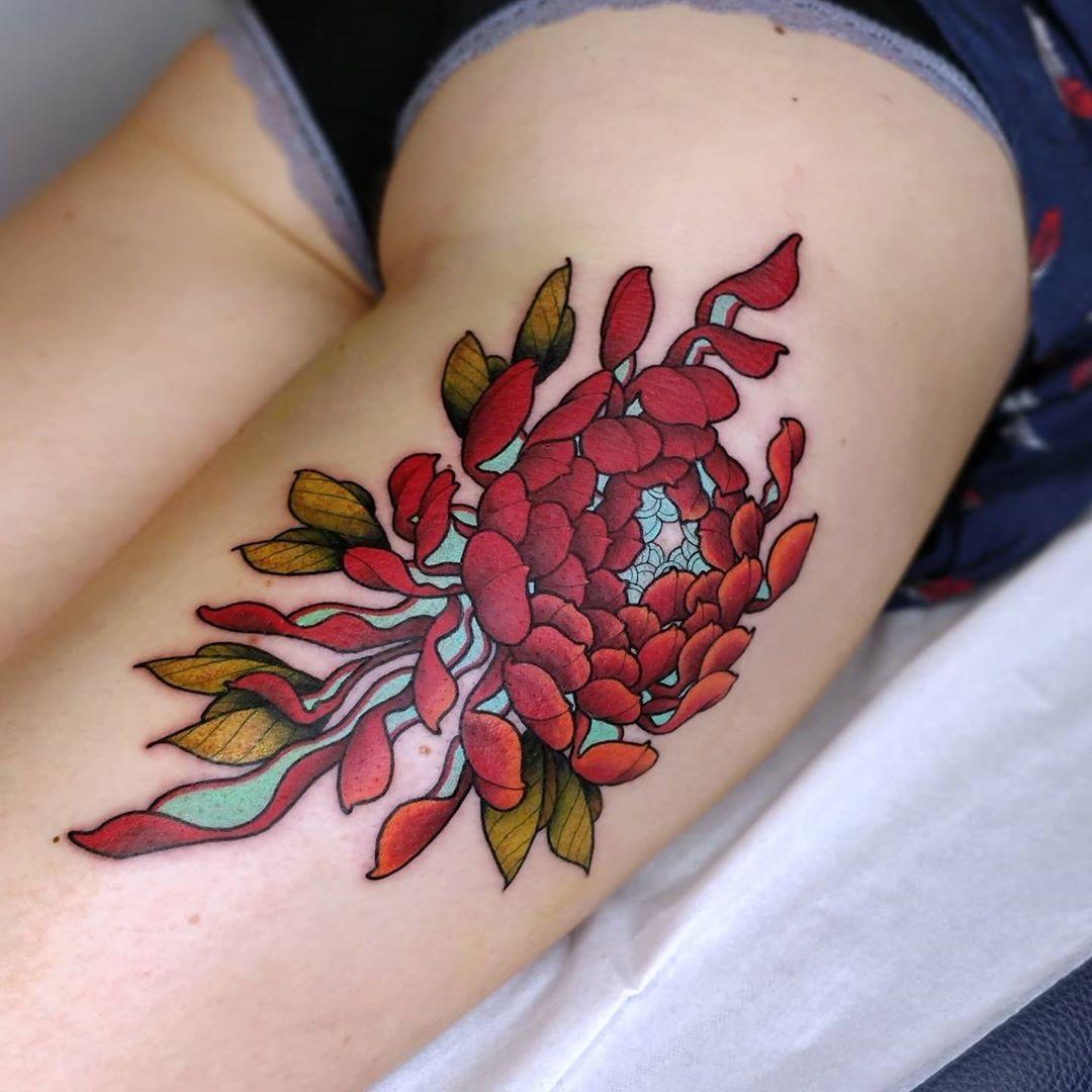 Chrysanthemum thigh tattoo