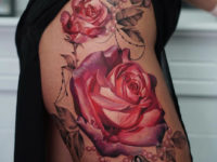 Pretty roses & pearls hip tattoo
