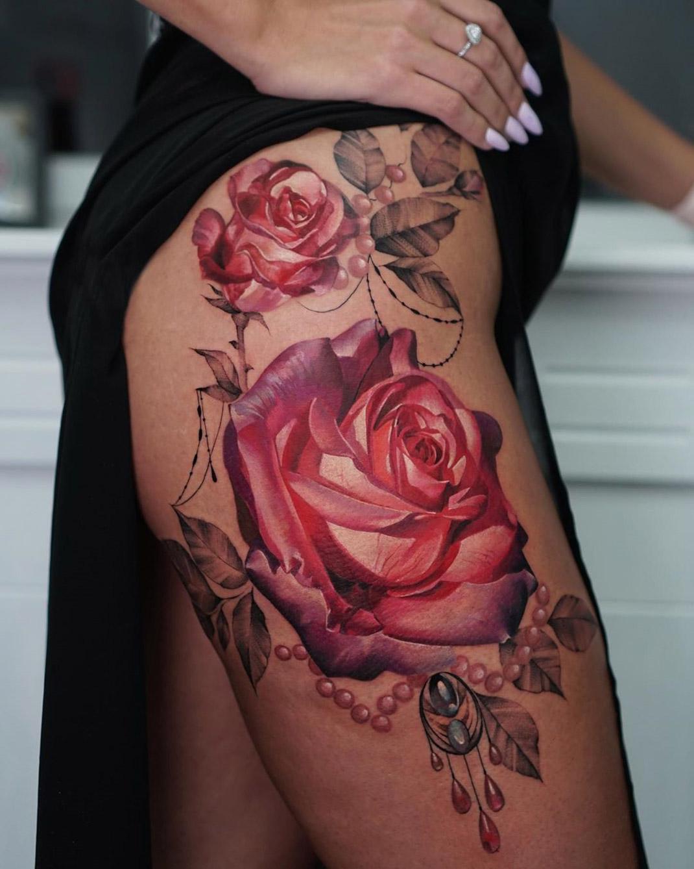 Pretty roses & pearls hip tattoo