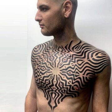 Men's chest pattern tattoo