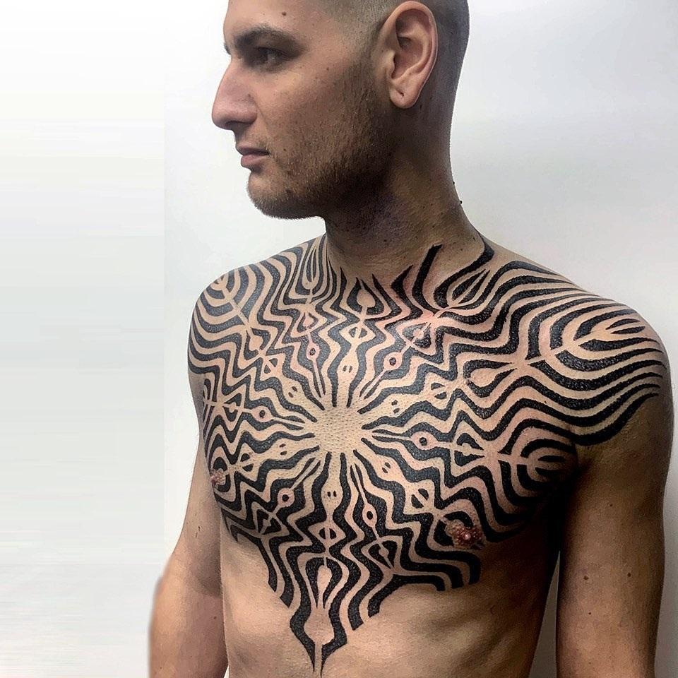 Men's chest pattern tattoo
