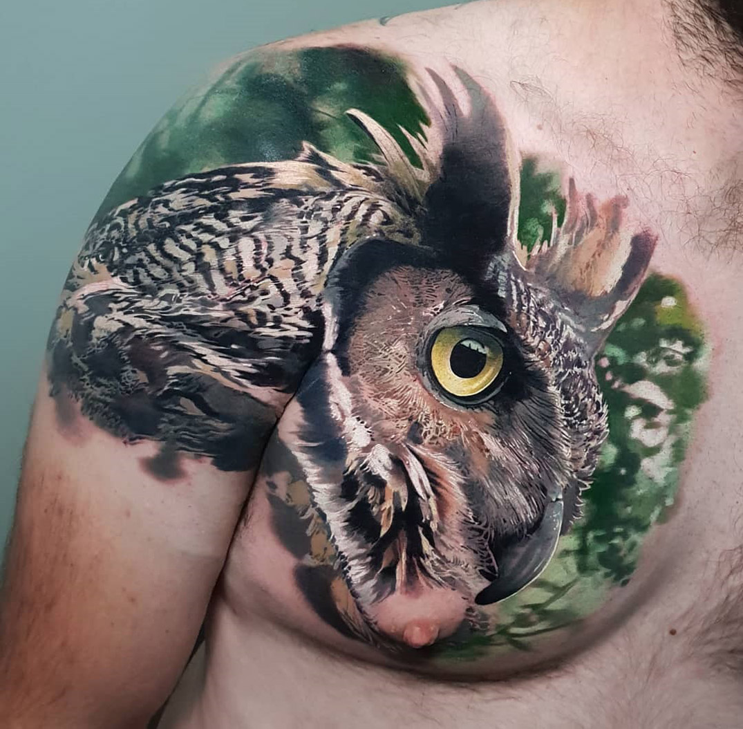 Owl tattoo on shoulder and chest