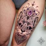 Ornamental Cat Thigh Tattoo